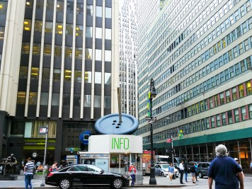 2WN in New York Garment District with Needle threading a button sculpture